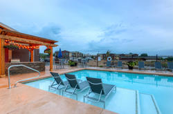 Outdoor Pool & Spa Area of The Legend Flats Apartments